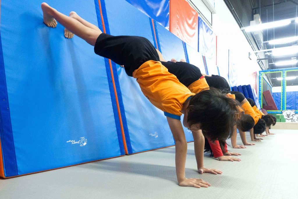 kids doing walk up the wall exercise